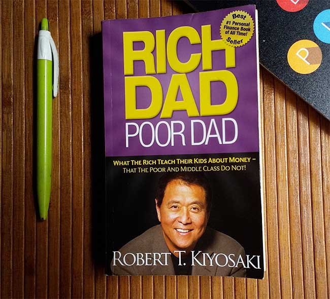 Rich Dad Poor Dad - What The Rich Teach Their Kids About Money That the Poor and Middle Class Do Not! by Robert T. Kiyosaki