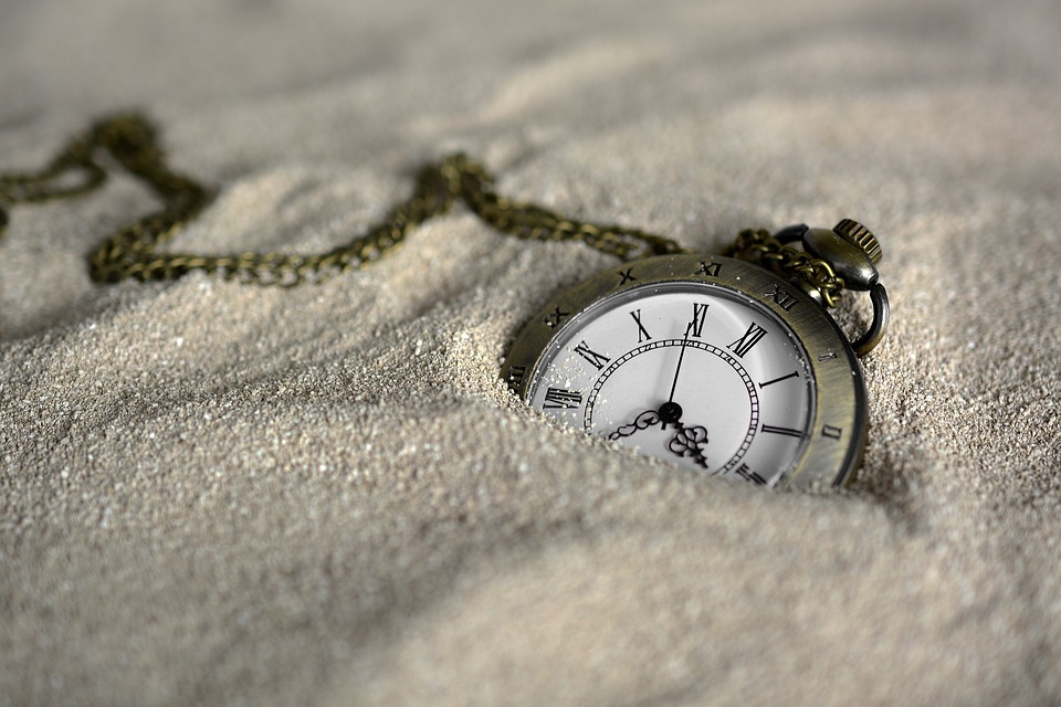 pocketwatch in sand representing the passage of time